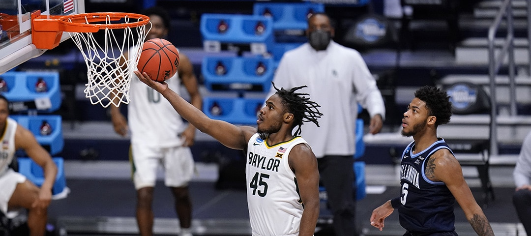Baylor guard Davion Mitchell (45) drives past Villanova guard Justin Moore (5) in the second half of a Sweet 16 game