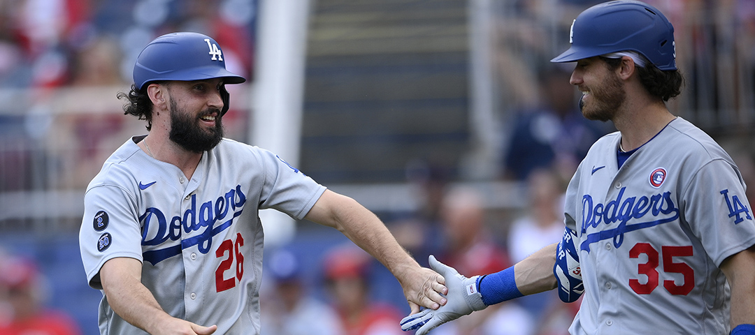 Los Angeles Dodgers' Tony Gonsolin (26) reacts with Cody Bellinger (35)