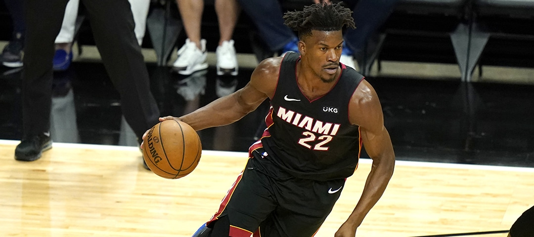 Miami Heat forward Jimmy Butler (22) drives to the basket