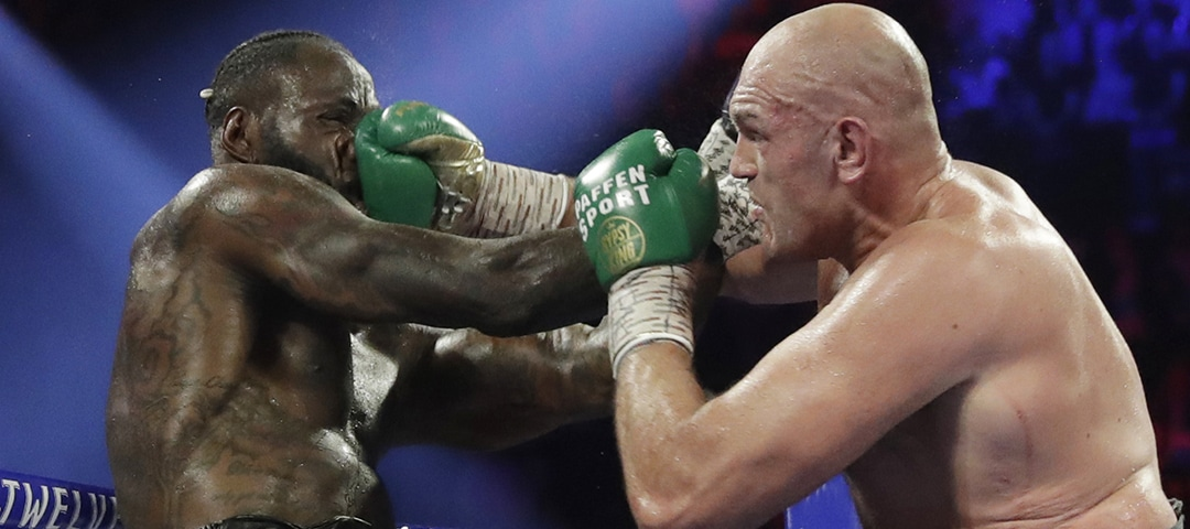 Tyson Fury, of England, lands a right to Deontay Wilder