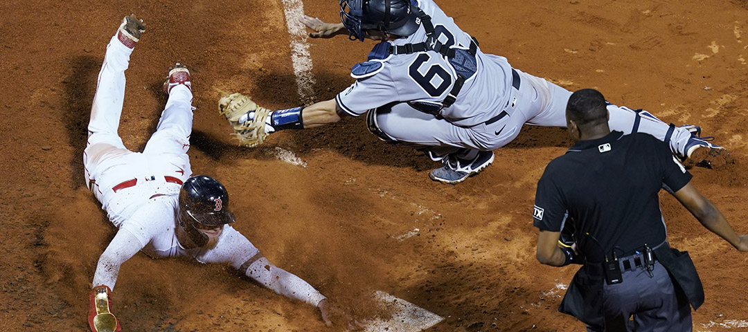 New York Yankees catcher Rob Brantly stretches for the tag